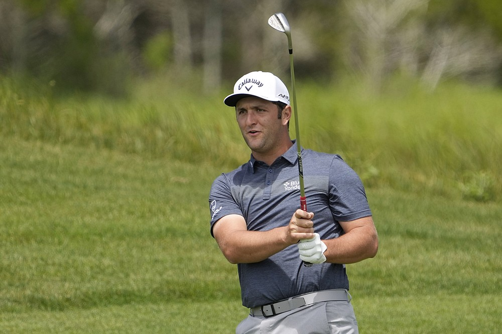Jon Rahm, of Spain, watches his chip shot to the 10th green during a practice round at the PGA Championship golf tournament on the Ocean Course Wednesday, May 19, 2021, in Kiawah Island, S.C. (AP Photo/David J. Phillip)