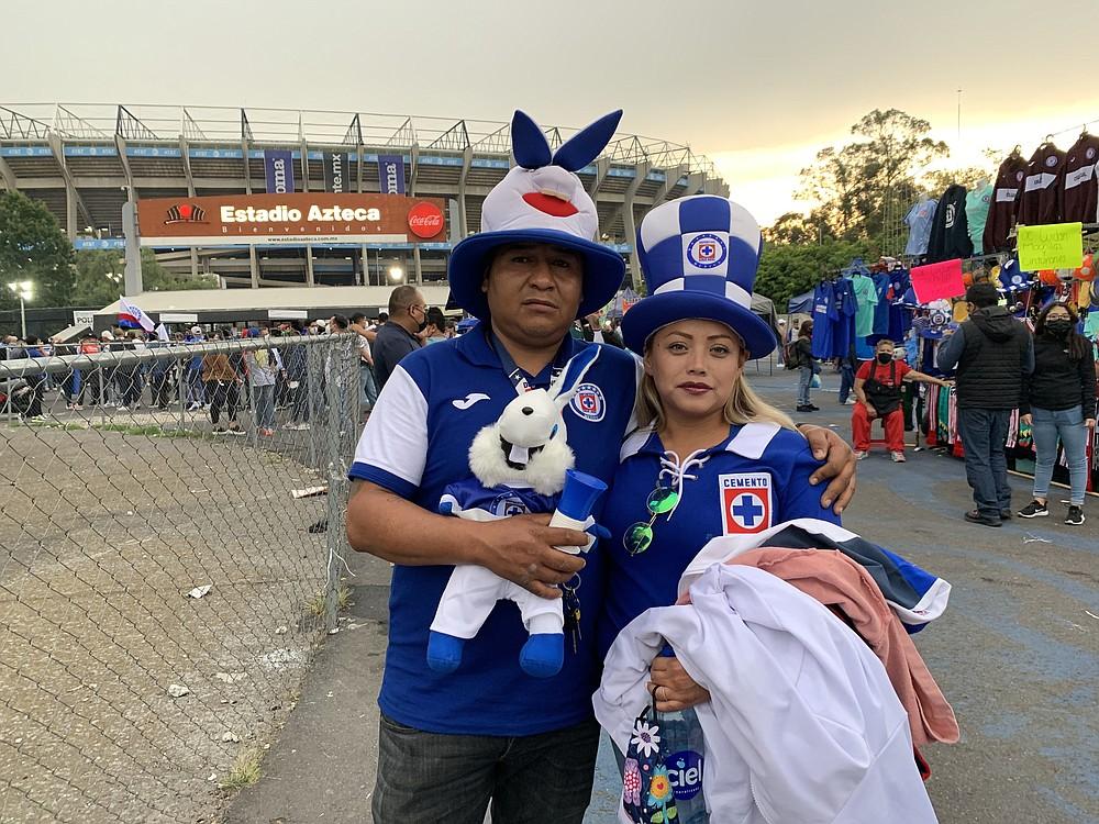 Alvaro Jesus Rosas and his wife, Ivonne Medina, arrive at Azteca Stadium. MUST CREDIT: Washington Post photo by Mary Beth Sheridan.