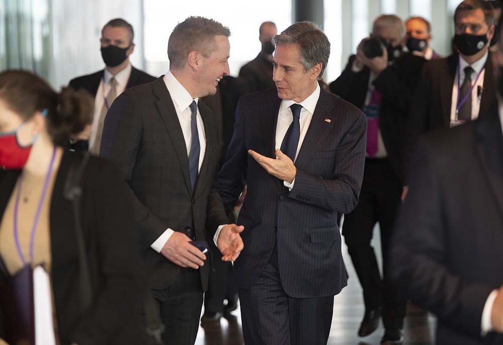 Icelandic Foreign Minister Gudlaugur Thor Thordarson, centre left, talks with US Secretary of State Antony Blinken as he arrives for the Arctic Council Working Dinner at the Harpa Concert Hall in Reykjavik, Iceland, Wednesday May 19, 2021. (Saul Loeb, Pool Photo via AP)