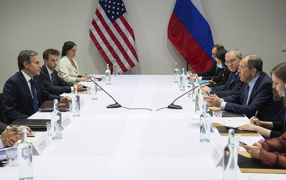 U.S. Secretary of State Antony Blinken, left, meets with Russian Foreign Minister Sergey Lavrov, right, at the Harpa Concert Hall in Reykjavik, Iceland, Wednesday, May 19, 2021, on the sidelines of the Arctic Council Ministerial summit. (Saul Loeb/Pool Photo via AP)