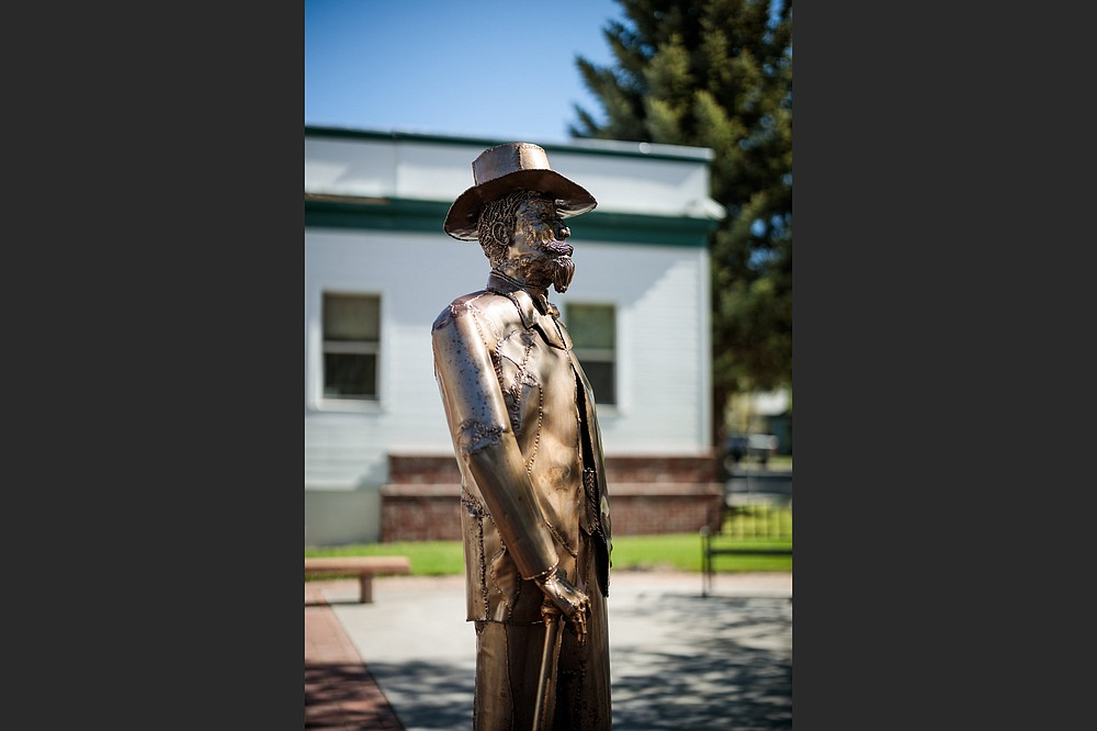 A statue of town founder Abner Weed looks out over downtown Weed, Calif. Would the 19th-century timber baron get a chuckle out of what his name has come to mean? (The New York Times/Max Whittaker)