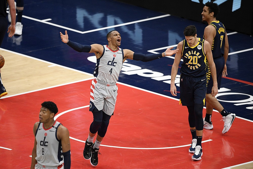 Washington Wizards guard Russell Westbrook (4) reacts next to Indiana Pacers forward Doug McDermott (20) and guard Malcolm Brogdon (7) during the second half of an NBA basketball Eastern Conference play-in game Thursday, May 20, 2021, in Washington. (AP Photo/Nick Wass)
