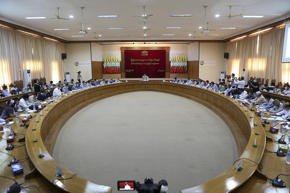 The Union Election Commission meets with representatives of various political parties Friday, May 21, 2021, in Naypyitaw, Burma. The head of Burma's military-appointed state election commission said Friday his agency will consider dissolving the former ruling party of Aung San Suu Kyi for its alleged involvement in electoral fraud, and have its leaders charged with treason. (AP Photo)