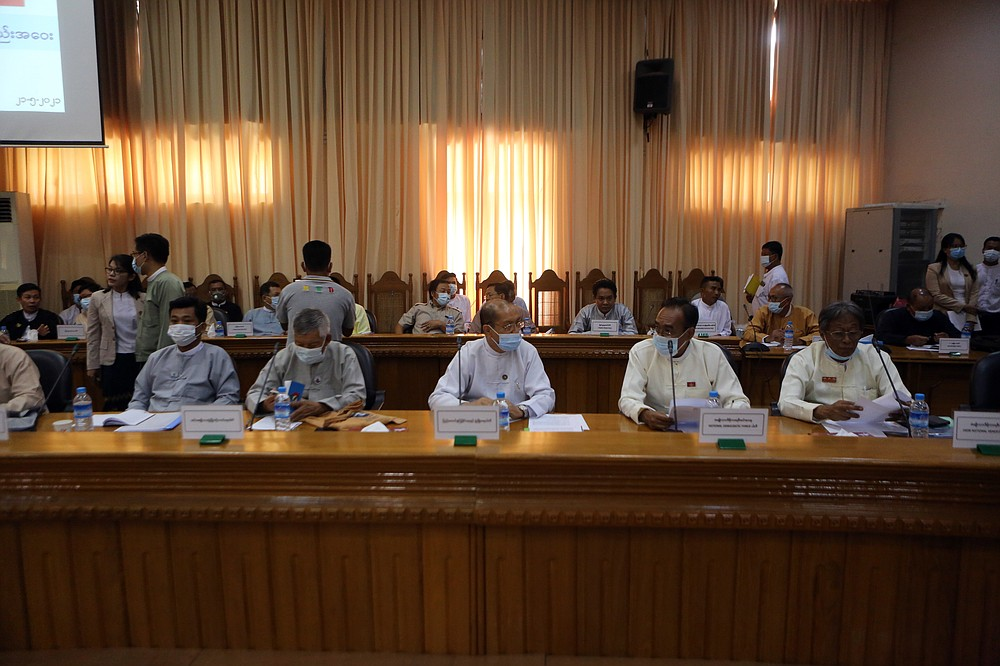 Representatives of various political parties attend a meeting organized by the Union Election Commission Friday, May 21, 2021 in Naypyitaw, Burma. The head of Burma's military-appointed state election commission says his agency will consider dissolving Aung San Suu Kyi's former ruling party for its alleged involvement in electoral fraud and have its leaders charged with treason. (AP Photo)
