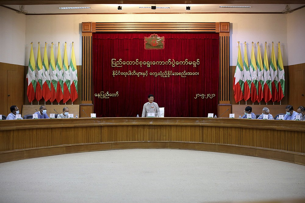 Union Election Commission Chairman Thein Soe, center, speaks during a meeting with representatives of various political parties Friday, May 21, 2021 in Naypyitaw, Burma. The head of Burma's military-appointed state election commission said Friday his agency will consider dissolving the former ruling party of Aung San Suu Kyi for its alleged involvement in electoral fraud, and have its leaders charged with treason. (AP Photo)