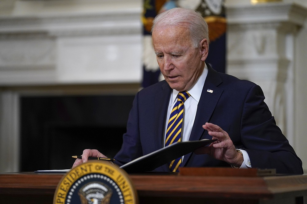 FILE - In this Feb. 24, 2021, file photo President Joe Biden closes the folder after signing an executive order relating to U.S. supply chains, in the State Dining Room of the White House in Washington. The Biden administration is giving a bit of simple advice to businesses that are unable to find workers: Offer them more money. This recommendation, included in a White House memo about the state of the economy, gets at a fundamental tension in an economy that is returning to full health after the coronavirus pandemic. (AP Photo/Evan Vucci, File)
