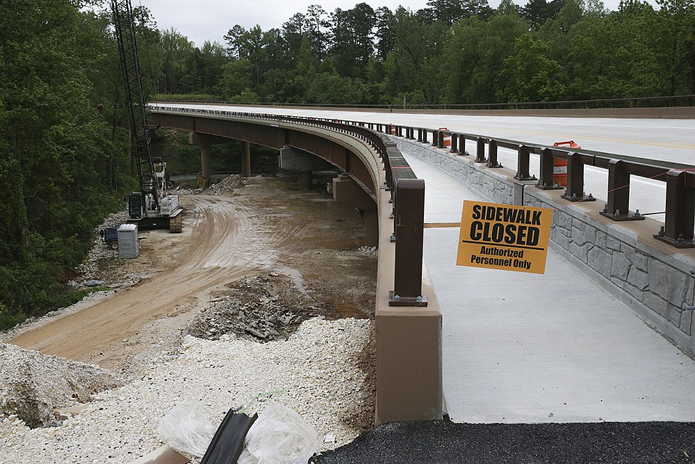 A walkway on the new bridge at Pruitt is almost ready for use. The bridge also has about 12 feet of clearance underneath, high enough for horseback riders to stay on the Old River Trail. Previously, they had to make a dangerous crossing on the old bridge. (NWA Democrat-Gazette/Charlie Kaijo)