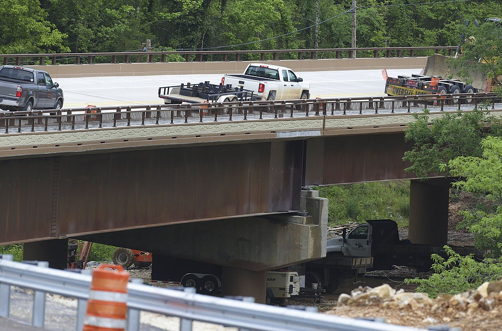 Vehicles cross the span Thursday that's replacing the old Pruitt bridge. The new bridge, which opened May 14, is 327 feet longer than the old span and 45 feet wide, compared with the old span's 20-foot width. (NWA Democrat-Gazette/Charlie Kaijo)