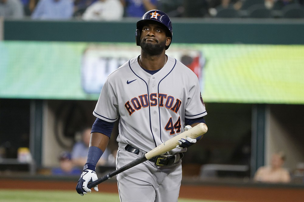 Houston Astros designated hitter Yordan Alvarez reacts after striking out against the Texas Rangers during the fourth inning of a baseball game Saturday, May 22, 2021, in Arlington, Texas. (AP Photo/Michael Ainsworth)