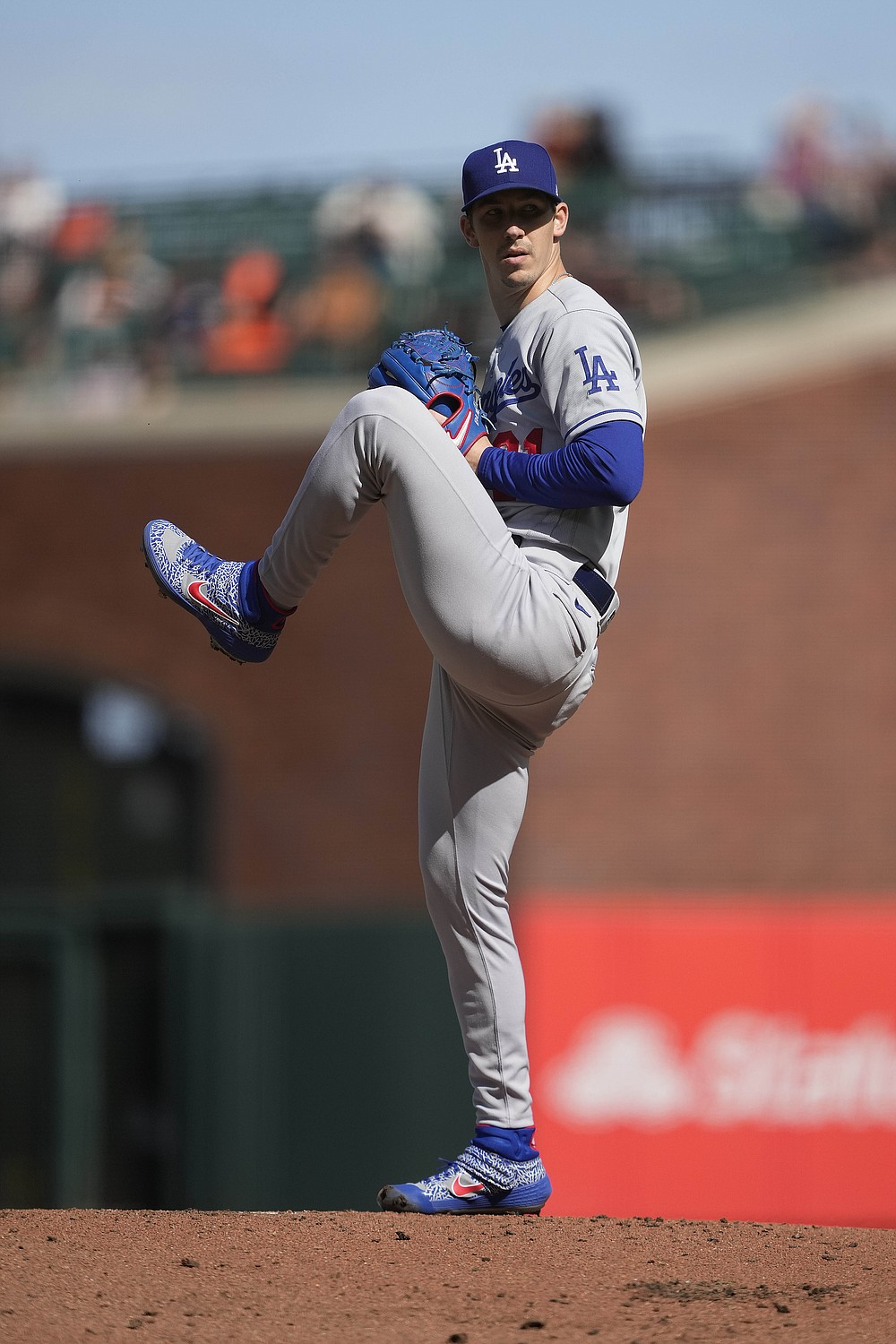 Los Angeles Dodgers starting pitcher Walker Buehler prepares to throw against the San Francisco Giants during the first inning of a baseball game Saturday, May 22, 2021, in San Francisco. (AP Photo/Tony Avelar)