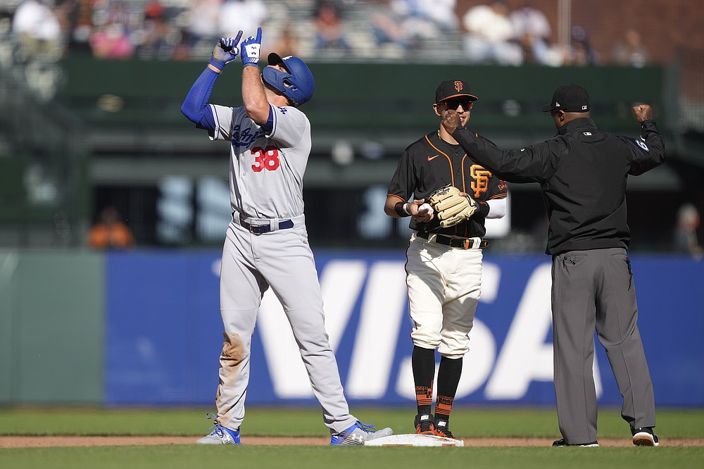 Los Angeles Dodgers' DJ Peters (38) points skyward after hitting a double against the San Francisco Giants during the fifth inning of a baseball game Saturday, May 22, 2021, in San Francisco. (AP Photo/Tony Avelar)