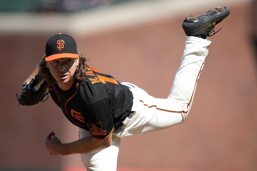 San Francisco Giants starting pitcher Scott Kazmir delivers against the Los Angeles Dodgers during the first inning of a baseball game Saturday, May 22, 2021, in San Francisco. (AP Photo/Tony Avelar)