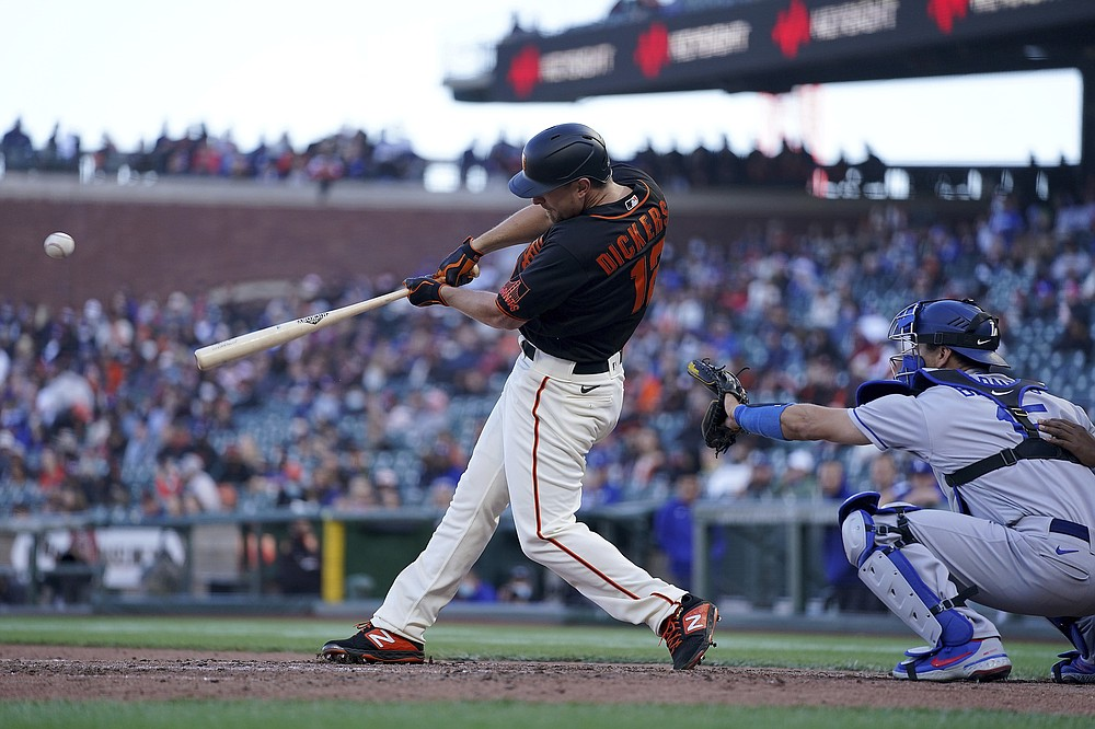 San Francisco Giants' Alex Dickerson (12) hits a single to drive in a run against the Los Angeles Dodgers during the seventh inning of a baseball game Saturday, May 22, 2021, in San Francisco. (AP Photo/Tony Avelar)