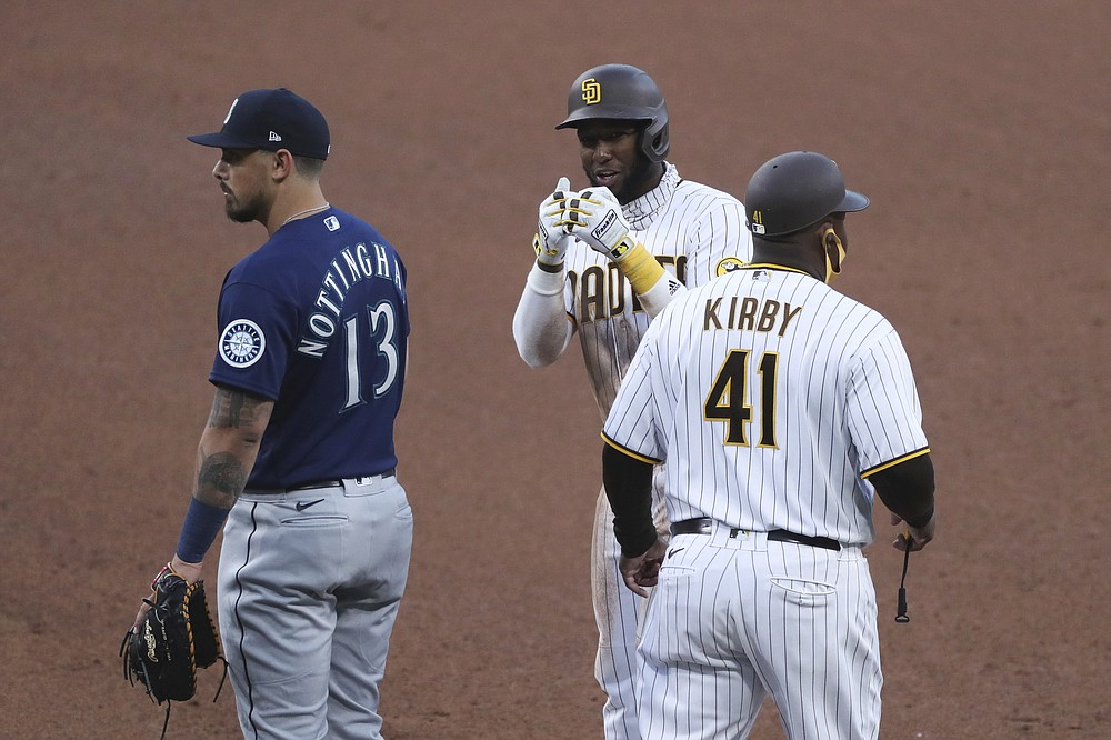 San Diego Padres' Jurickson Profar gestures toward the Padres dugout after singling to right field off Seattle Mariners' Justus Sheffield in the fifth inning of a baseball game Saturday, May 22, 2021, in San Diego. Tommy Pham advanced to third. (AP Photo/Derrick Tuskan)