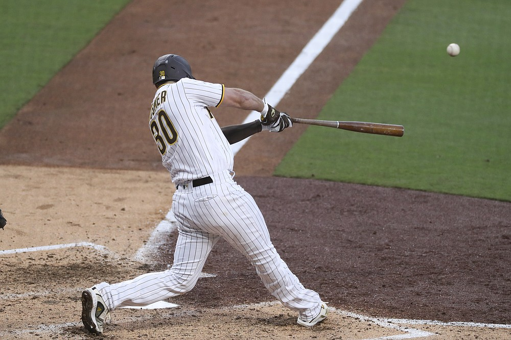 San Diego Padres' Eric Hosmer hits an RBI single to left off Seattle Mariners' Justus Sheffield during the fifth inning of a baseball game Saturday, May 22, 2021, in San Diego. (AP Photo/Derrick Tuskan)