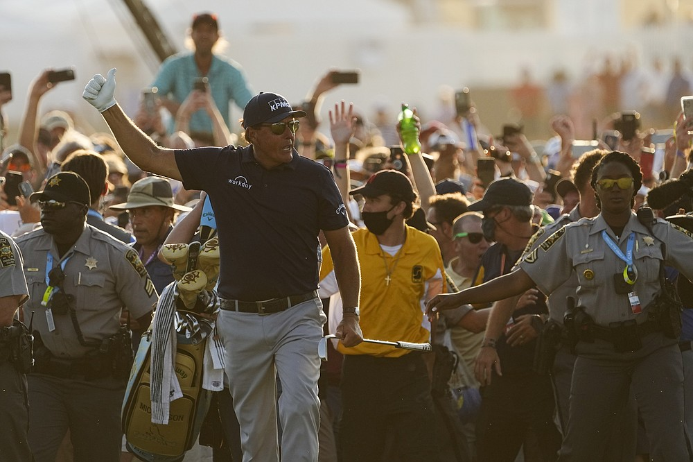 Phil Mickelson walks ahead of spectators during the final round at the PGA Championship golf tournament on the Ocean Course, Sunday, May 23, 2021, in Kiawah Island, S.C. (AP Photo/David J. Phillip)