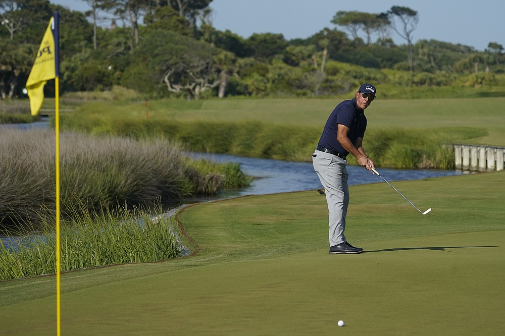 Phil Mickelson watches his putt on the 13th green during the final round at the PGA Championship golf tournament on the Ocean Course, Sunday, May 23, 2021, in Kiawah Island, S.C. (AP Photo/Matt York)