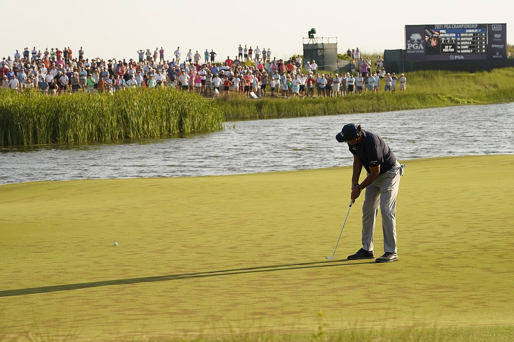 Phil Mickelson works on the 17th hole during the final round at the PGA Championship golf tournament on the Ocean Course, Sunday, May 23, 2021, in Kiawah Island, S.C. (AP Photo/Matt York)