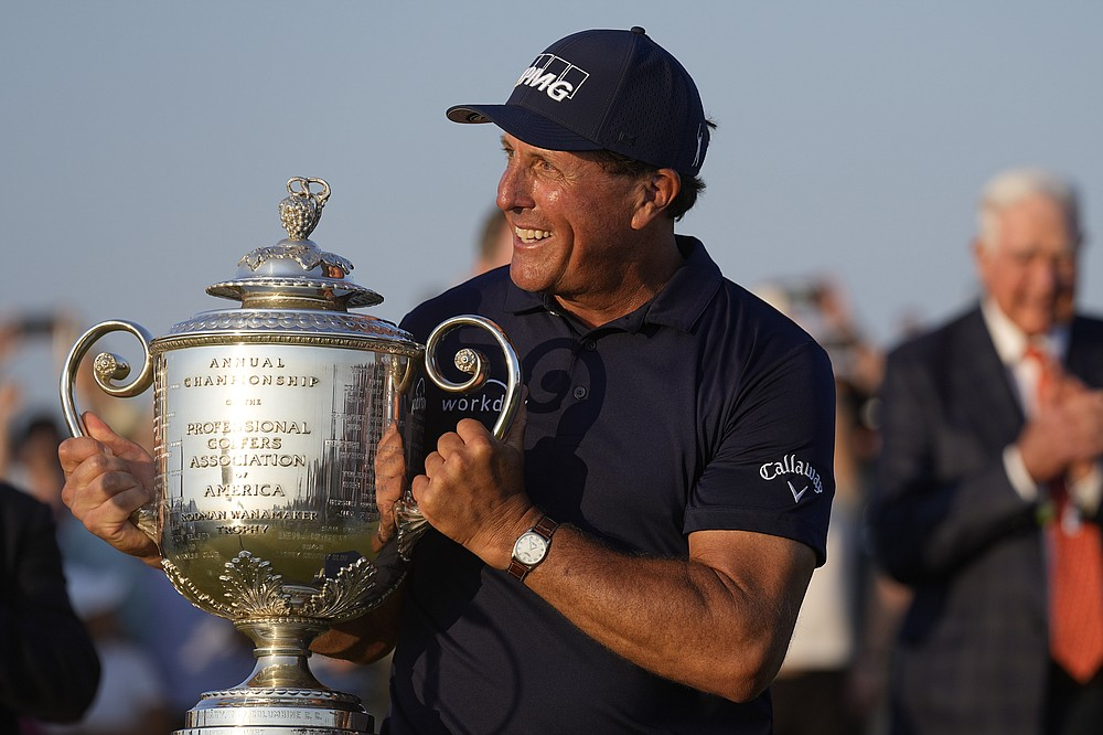 Phil Mickelson holds the Wanamaker Trophy after winning the final round at the PGA Championship golf tournament on the Ocean Course, Sunday, May 23, 2021, in Kiawah Island, S.C. (AP Photo/David J. Phillip)