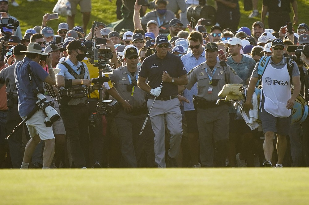 Phil Mickelson walks up the 18th fairway during the final round at the PGA Championship golf tournament on the Ocean Course, Sunday, May 23, 2021, in Kiawah Island, S.C. (AP Photo/Matt York)