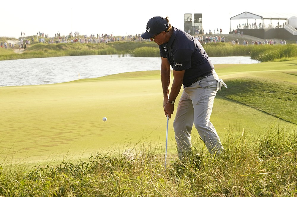 Phil Mickelson hits out of the rough the 17th hole during the final round at the PGA Championship golf tournament on the Ocean Course, Sunday, May 23, 2021, in Kiawah Island, S.C. (AP Photo/Matt York)