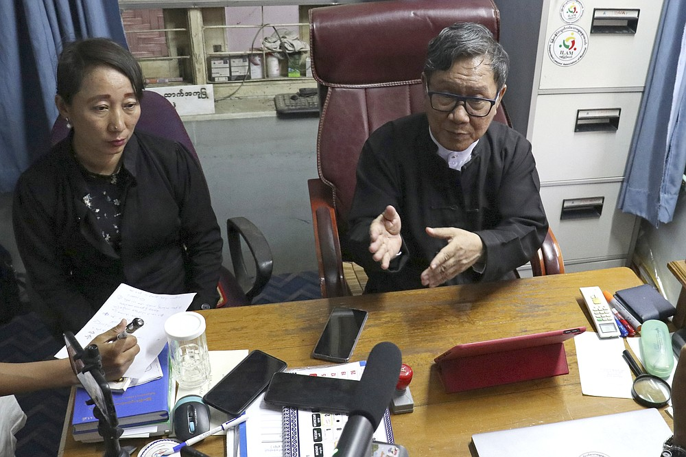 Khin Maung Zaw, right, with Min Min Soe, left, the lawyers assigned by the National League for Democracy party to represent deposed Myanmar leader Aung San Suu Kyi, speaks to journalists in Naypyitaw, Myanmar, Myanmar, Monday, May 24, 2021. Myanmar's ousted leader, Aung San Suu Kyi, appeared in court in person Monday for the first time since the military arrested her when it seized power on Feb. 1. (AP Photo)
