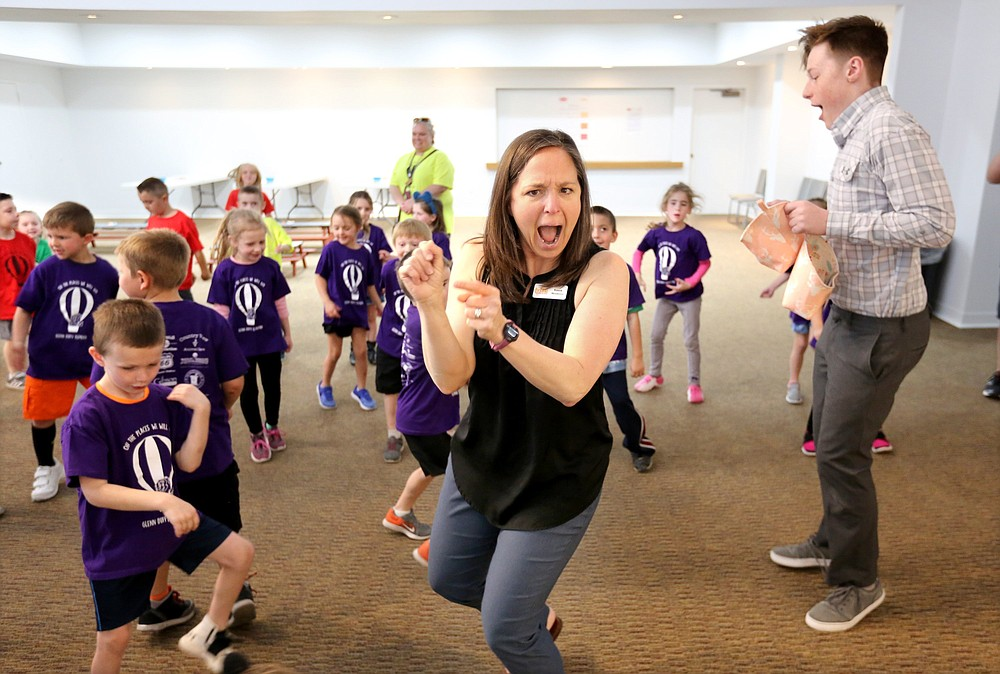 Kassie Misiewicz, founder of Trike Theatre, leads a preshow experience with kindergarten students from Glenn Duffy Elementary School in Gravette. Summer camps at Trike will let children learn about theater from the inside out.  (NWA Democrat-Gazette File Photo/David Gottschalk)