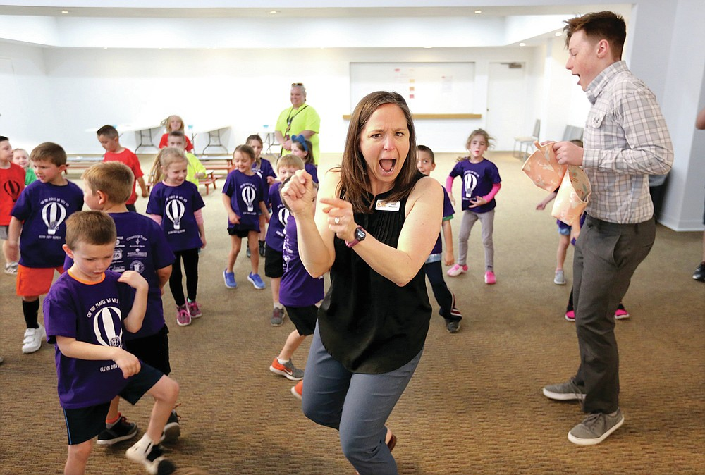 NWA Democrat-Gazette/DAVID GOTTSCHALK  Kassie Misiewicz, artistic director and founder of Trike Theatre, leads Wednesday, April 10, 2019, in an Act it Out pre show experience with kindergarten students from Glenn Duffy Elementary School in Gravette, at the Arts Center of the Ozarks in Springdale. The students were at the center to see Balloonacy, part of the Little Trike Series, at the center. The performance continues today through Saturday.
