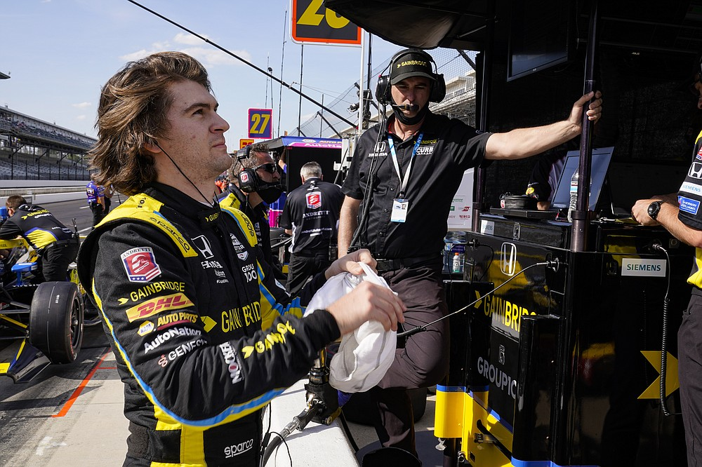 Colton Herta prepares to drives as his father Bryan Herta looks on during practice for the Indianapolis 500 auto race at Indianapolis Motor Speedway in Indianapolis, Friday, May 21, 2021. (AP Photo/Michael Conroy)