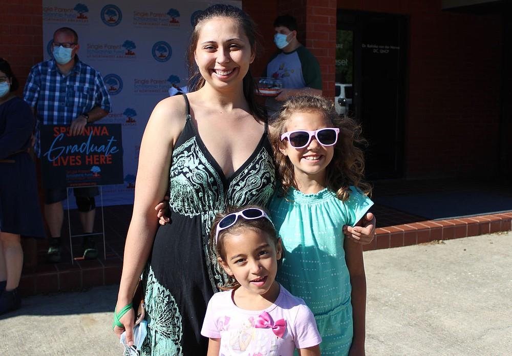 Destiny Draper, 2021 graduate (from left) and daughters Alayna Wade and Aubriella Wade attend the graduation celebration.  (NWA Democrat-Gazette/Carin Schoppmeyer)