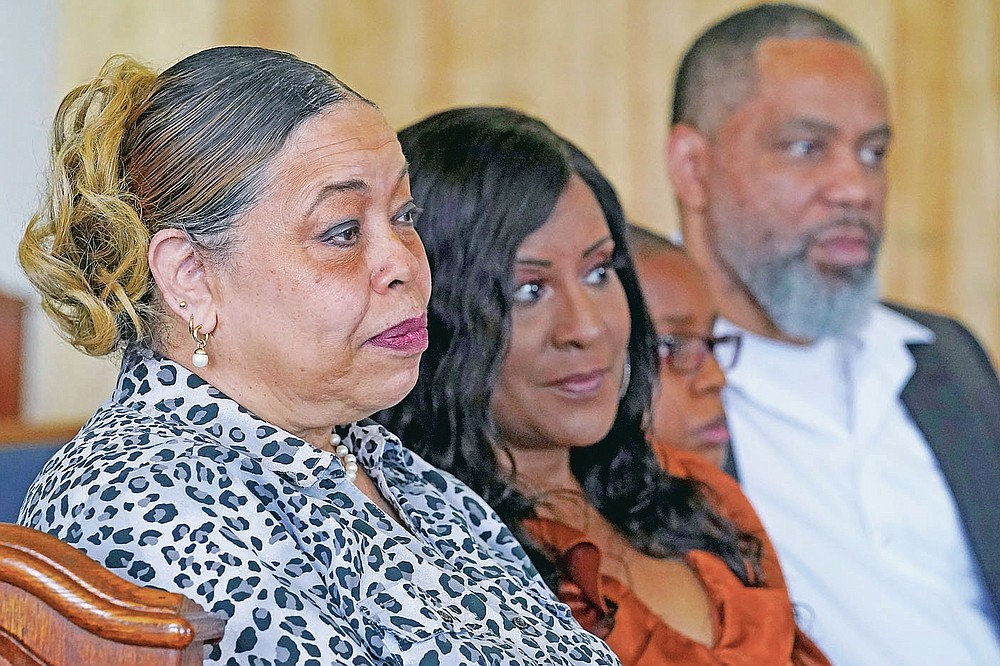 """Descendants of Tulsa Race Massacre survivor Ernestine Alpha Gibbs sit together during an interview in Tulsa, Okla., on Sunday, April 11, 2021. From left are her daughter, Carolyn Roberts; granddaughter-in-law, Tracy Gibbs; great-grandson, LeRoy Gibbs III, and grandson LeRoy Gibbs II. LeRoy II credits his grandmother, who not only built wealth and passed it on, but also showed succeeding generations how it was done. It was a lesson that few descendants of the victims of the race massacre had an opportunity to learn. """"The perseverance of it is what she tried to pass on to me,"""" said LeRoy Gibbs II. """"We were fortunate that we had Ernestine and LeRoy … They built their business."""" (AP Photo/Sue Ogrocki)"""