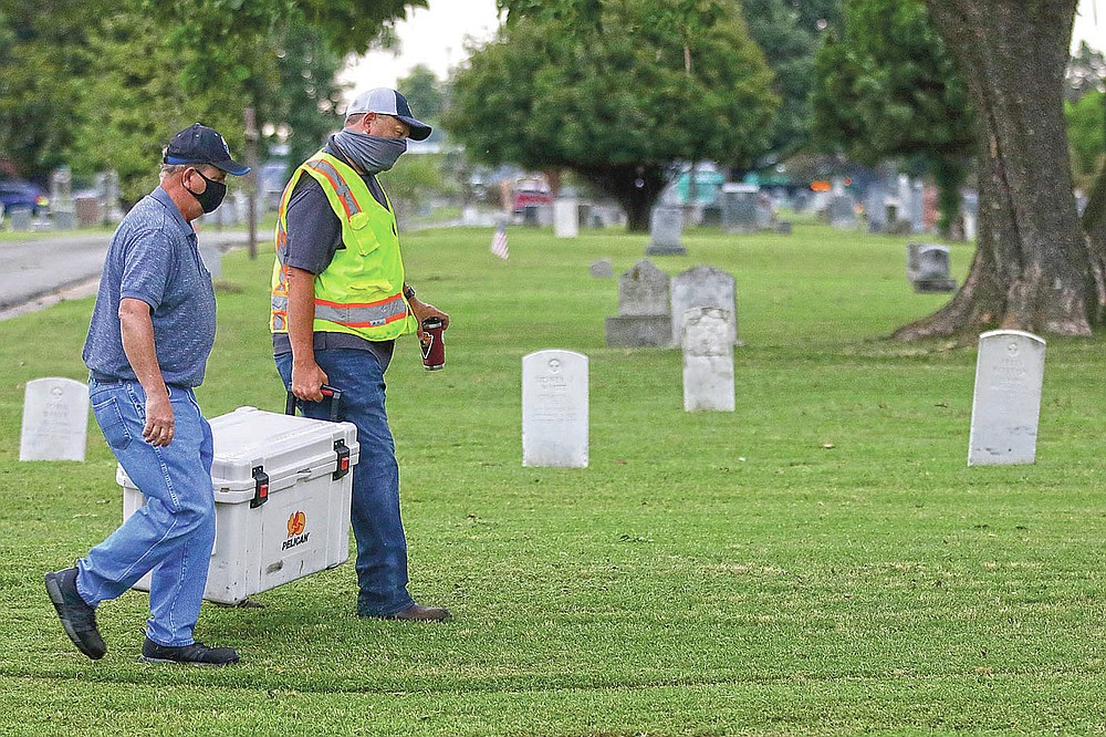 Workers move equipment into position at Oaklawn Cemetery prior to a test excavation in the search for possible mass graves from the 1921 Tulsa Race Massacre. (Mike Simons/Tulsa World via AP)