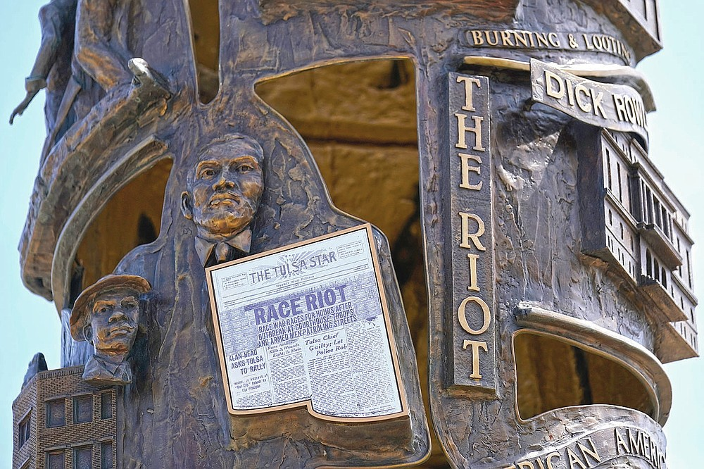 A sculpture commemorating the Tulsa Race Massacre stands in John Hope Franklin Reconciliation Park in Tulsa, Okla., on Wednesday, April 14, 2021. (AP Photo/Sue Ogrocki)