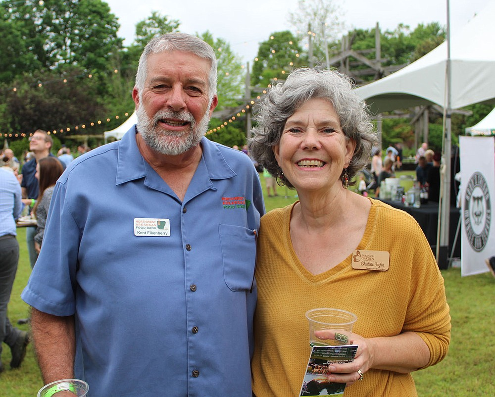 Kent Eikenberry, Northwest Arkansas Food Bank president and CEO, and Charlotte Taylor, Botanical Garden of the Ozarks executive director, stand for a photo at Chefs in the Garden. The food bank was a beneficiary of the fundraiser. (NWA Democrat-Gazette/Carin Schoppmeyer)