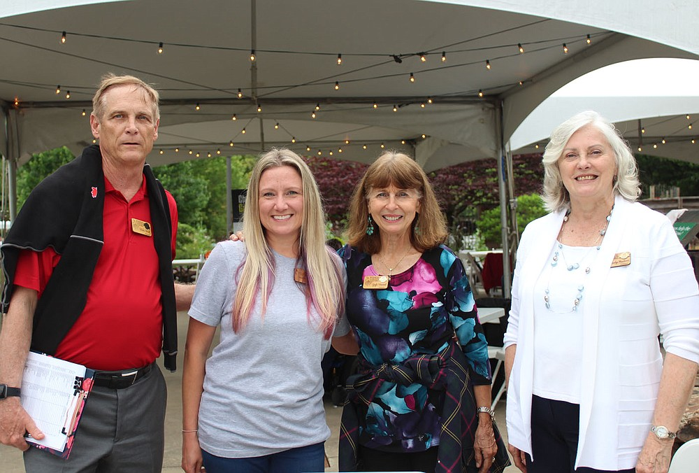 Mike Wulf, Heather Silva, Gayle Howard and Marilyn Misenhimer, Botanical Garden of the Ozarks volunteers, welcomed guests to the fundraiser May 25. (NWA Democrat-Gazette/Carin Schoppmeyer)
