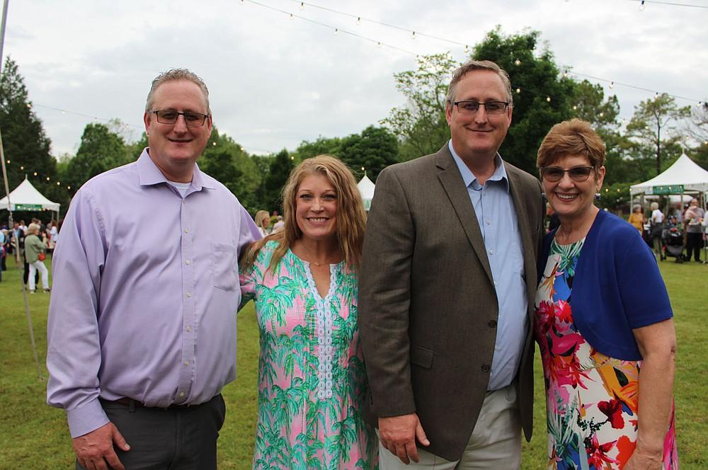 Bryan and Cari Lewis (from left), Steve Lewis and Nancy Pinkerton enjoy Chefs in the Garden. (NWA Democrat-Gazette/Carin Schoppmeyer)