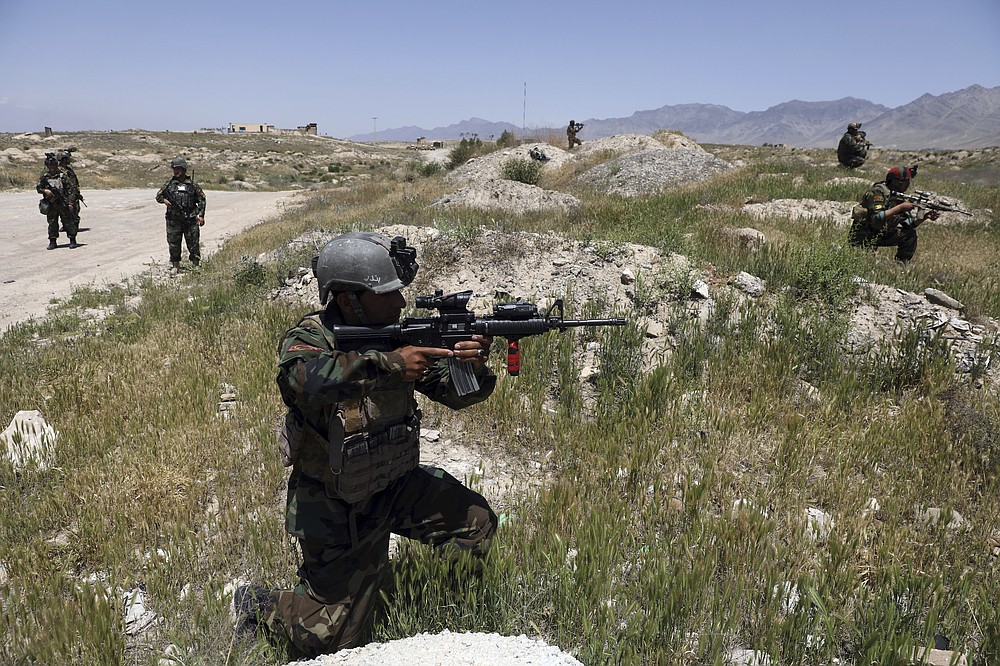 Afghan soldiers patrol outside their military base on the outskirts of Kabul, Afghanistan, Sunday, May 9, 2021. By Sept. 11 2021, at the latest, the remaining U.S.and allied NATO forces will leave Afghanistan, ending nearly 20 years of military engagement. Also leaving is the American air support that the Afghan military has relied on to stave off potentially game-changing Taliban assaults, ever since it took command of the war from the U.S. and NATO in 2014. (AP Photo/Rahmat Gul)