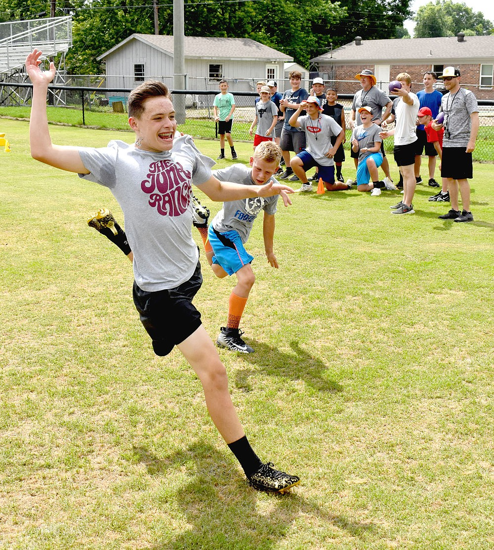 MARK HUMPHREY  ENTERPRISE-LEADER/Prairie Grove rising seventh grader Brody Williamson wins the race of champions — beating the fourth, fifth and sixth grade winners during Prairie Grove's pee wee football camp last week.