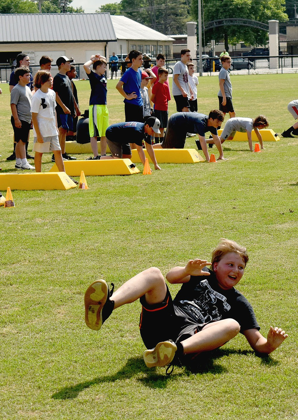 MARK HUMPHREY  ENTERPRISE-LEADER/Prairie Grove rising sixth grader Mayson Chronister rolls out of a bear crawl while participating in an agility drill during Prairie Grove's annual pee wee football camp on Wednesday, June 9, 2021.