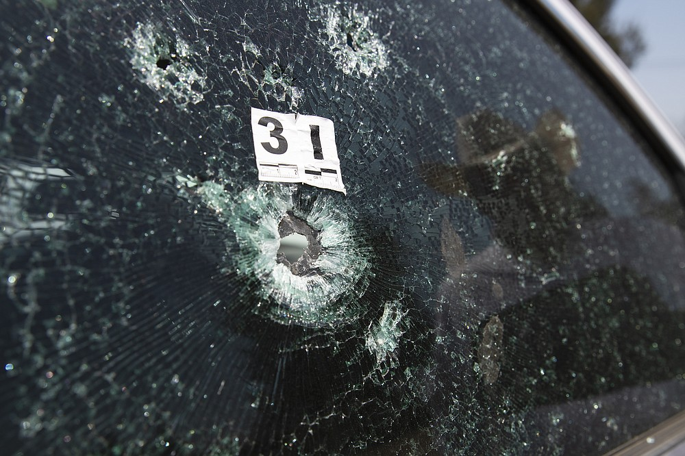 The windshield of mayoral candidate Guillermo Valencia is shattered after an attack in Morelia, Michoacan state, Mexico, Saturday, May 22, 202. The PRI candidate was not in the car and two members of his team survived the May 8 attack when a car pulled up and two young gunmen leaped out, one with an assault rifle and another with a pistol went around to finish off anybody trying to flee. (AP Photo/Marco Ugarte)