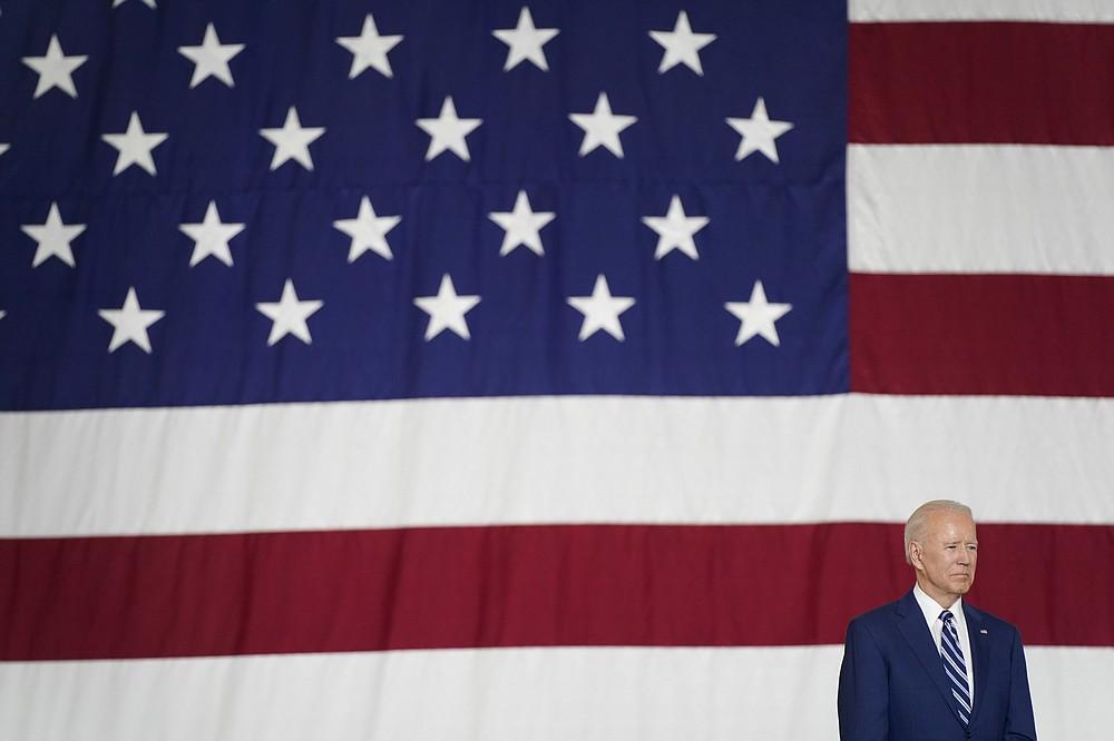 President Joe Biden listens as first lady Jill Biden speaks at Joint Base Langley-Eustis in Hampton, Va., Friday, May 28, 2021. (AP Photo/Patrick Semansky)