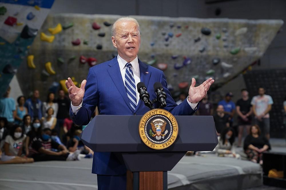 President Joe Biden speaks at Sportrock Climbing Centers, Friday, May 28, 2021, in Alexandria, Va. (AP Photo/Evan Vucci)