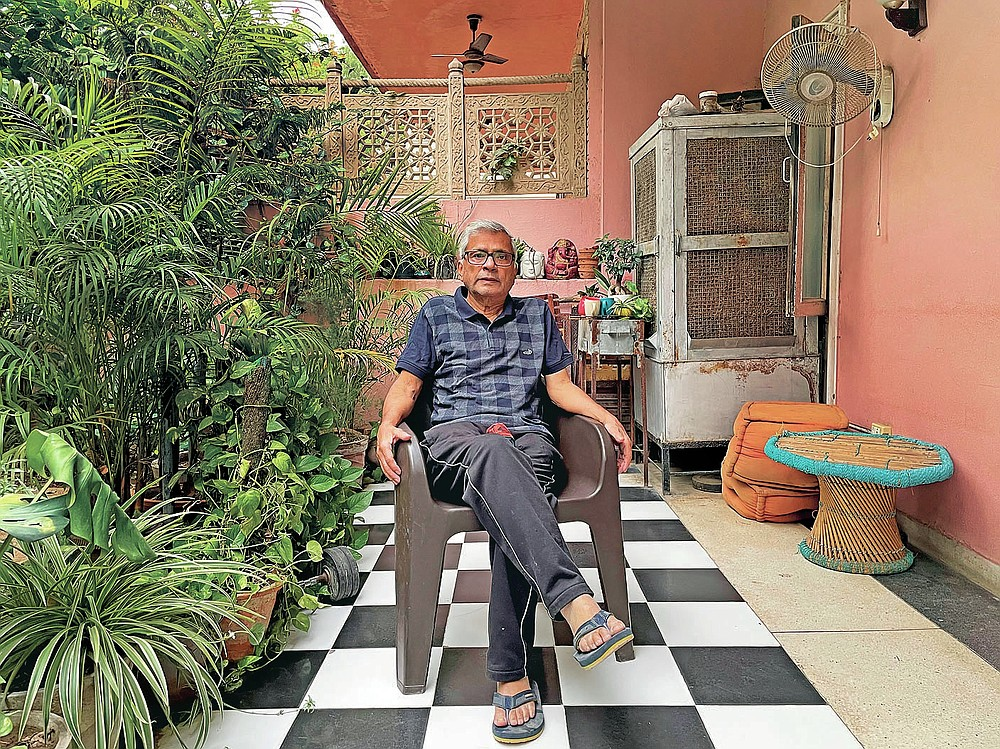 In this photo released by Chakravorty family, Prabir Chakravorty, 73, a COVID-19 survivor, sits in the garden area of his home in New Delhi, India on May 17, 2021. Chakravorty, the family patriarch and widower, a construction executive was treated at home for the coronavirus. (Chakravorty family via AP)