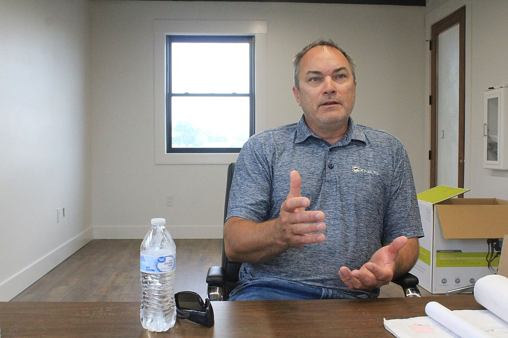 Lloyd Sumpter of Rival CRE discusses the renovation of the barracks and buildings in the Buckhorn Street district on Thursday, May 27, 2021, inside one of the buildings.