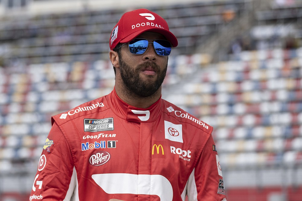 Bubba Wallace waits for his qualifying run for the NASCAR Cup Series auto race at Charlotte Motor Speedway on Saturday, May 29, 2021 in Charlotte, N.C. (AP Photo/Ben Gray)