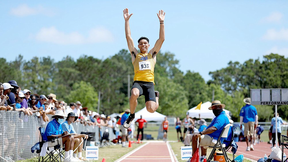 Photo courtesy of JBU Sports Information John Brown sophomore Will Vail competes in the long jump Thursday, May 27, at the NAIA National Championships held at Mickey Miller Blackwell Stadium inside the Gulf Shores Sportsplex in Gulf Shores, Ala.