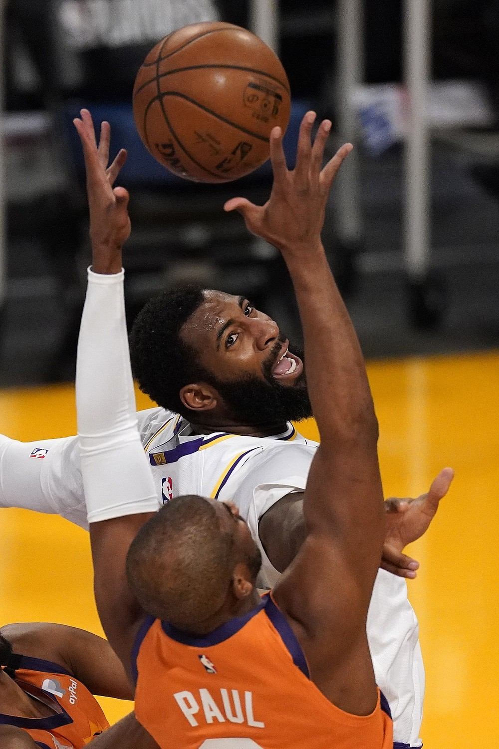 Los Angeles Lakers center Andre Drummond, top, and Phoenix Suns guard Chris Paul go after a rebound during the first half in Game 4 of an NBA basketball first-round playoff series Sunday, May 30, 2021, in Los Angeles. (AP Photo/Mark J. Terrill)