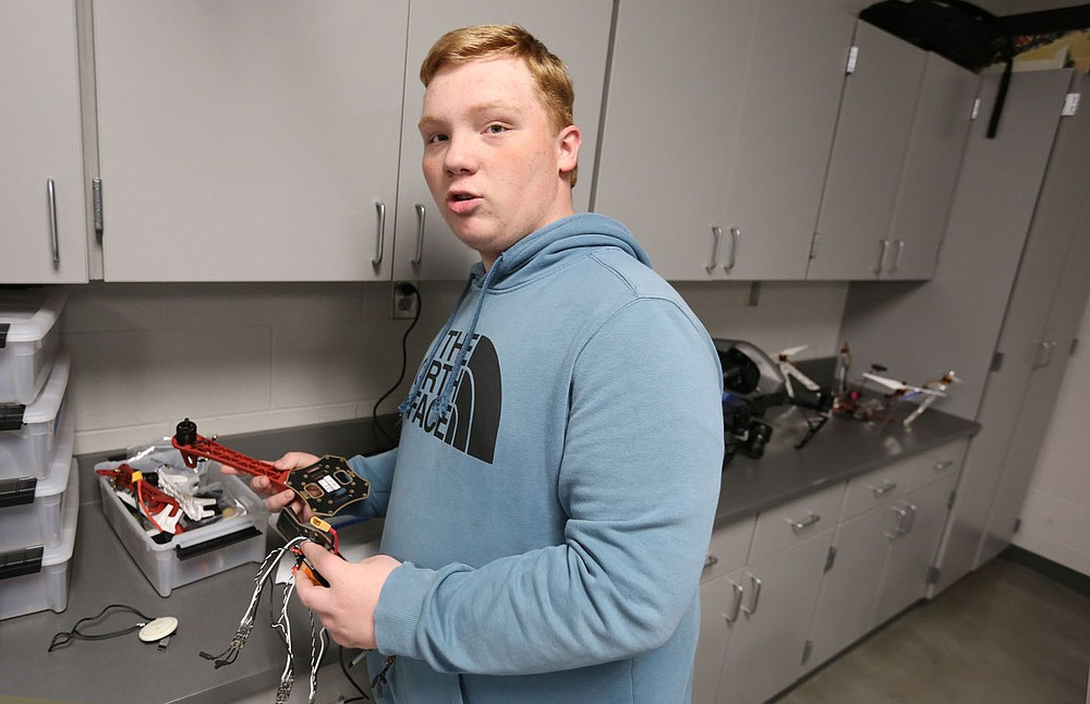Kyle King, a ninth grade student at Elkins High School, displays Monday, May 17, 2021, a wiring harness, in the former computer lab classroom at the high school. Elkins High School and Elkins Middle School will be partnering with Amazon in the years ahead to enhance the district's computer science program. The high school will be renovating a classroom this summer in order to create a state-of-the-art maker space for computer science and robotics for students next year. Check out nwadg.com/photos for a photo gallery. (NWA Democrat-Gazette/David Gottschalk)