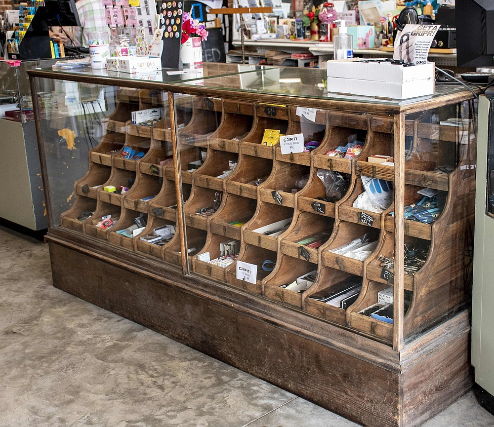 An antique display case at Art Outfitters dates from the historic shop founded by John A. Jungkind in 1881. (Arkansas Democrat-Gazette/Cary Jenkins)