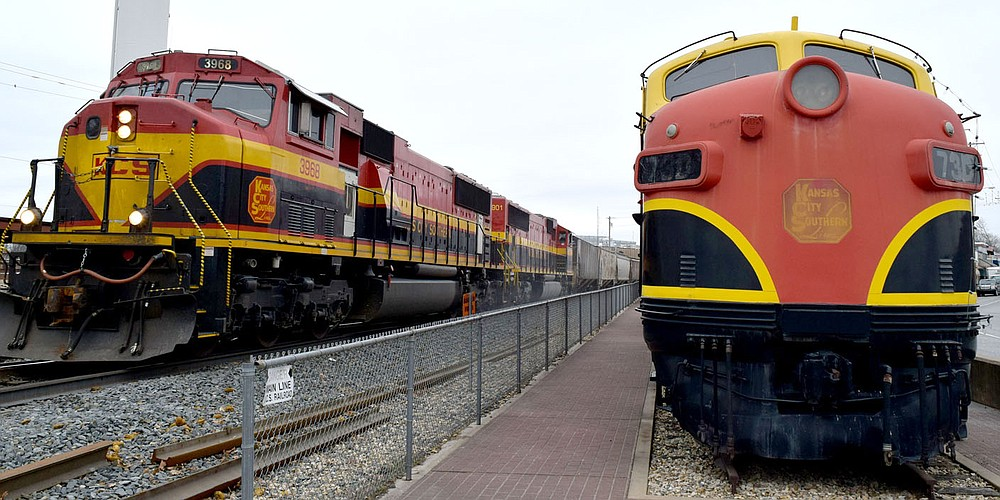 Westside Eagle Observer/MIKE ECKELS  The old and the fairly new. A Kansas City Southern EMD SD70MAC (left), built in 2000 powers past a 1950 EMD F7A locomotive on permeant display at the depot in Decatur  January 26, 2018. The history of the Kansas City Railroad dated to 1887 when Arthur Stillwell founded the Kansas City Suburban Belt Railway.